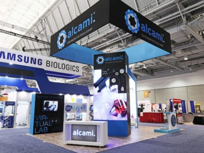 20 by 20 custom modular rental exhibit for Alcami at Bio International 2018, a biotechnology trade show, built by Apogee Exhibits and Environments.