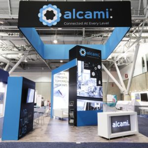 20 by 20 custom modular rental exhibit for Alcami at Bio International 2018 with VR station, built by Apogee Exhibits and Environments.