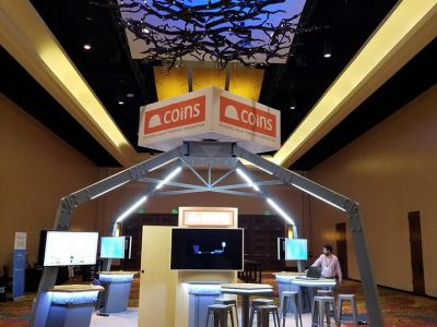 Custom 20 by 20 trade show display for Construction Industry Solutions (COINS) for their 2018 user conference, built by Apogee Exhibits and Environments.